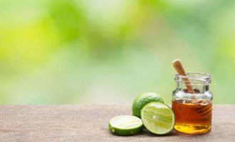 Fresh lemon and honey natural on wooden table of natural background with free space